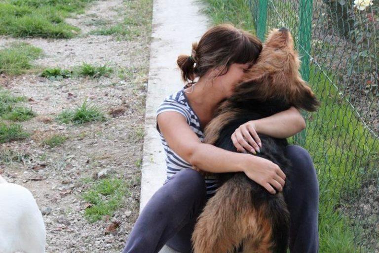 rescuer hugging rescue dog